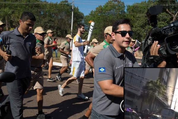 Cuiabano tenta apagar tocha olímpica com balde d'água durante revezamento;  vídeo
